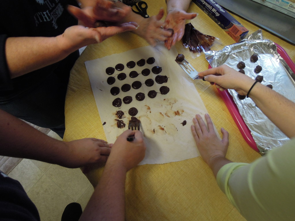 All hands are needed for truffle making.