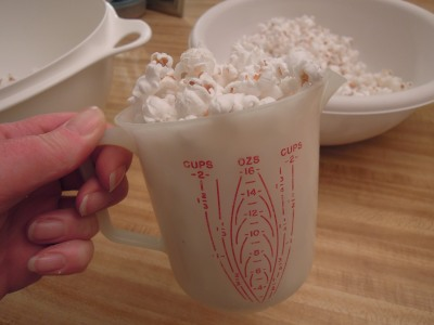 I used a plastic 2 cup pitcher for a rough measurement of 12 cups of popcorn.